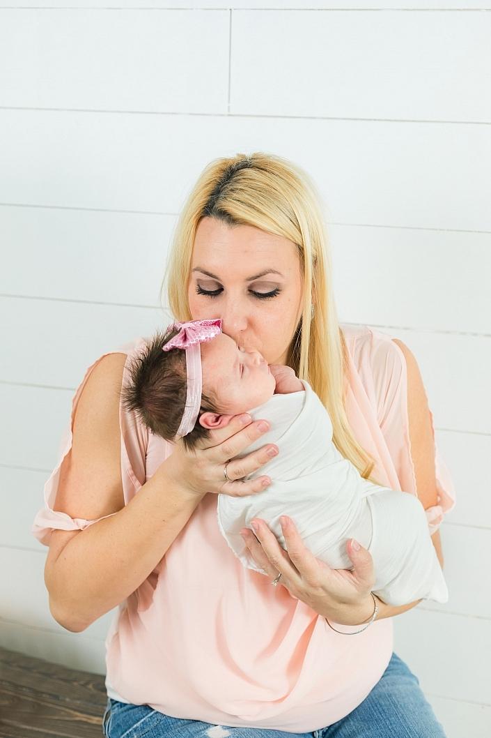 gilbert mom holding her baby