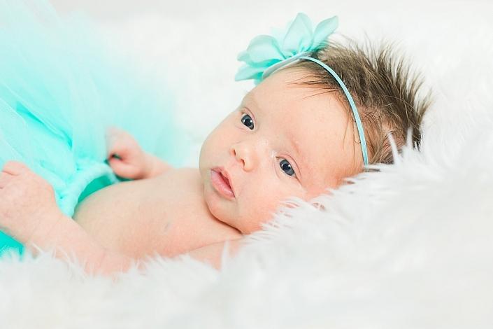 newborn in a blue tutu
