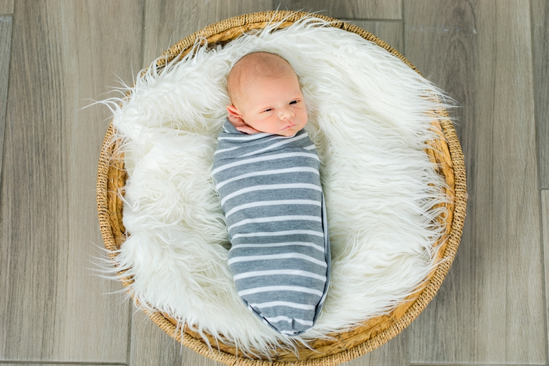 newborn in a striped wrap