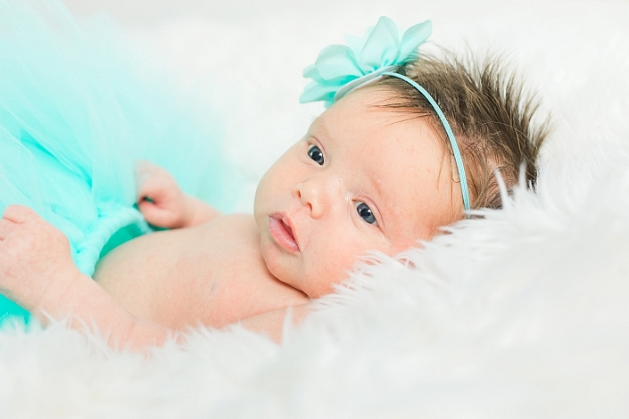 newborn in a blue tutu