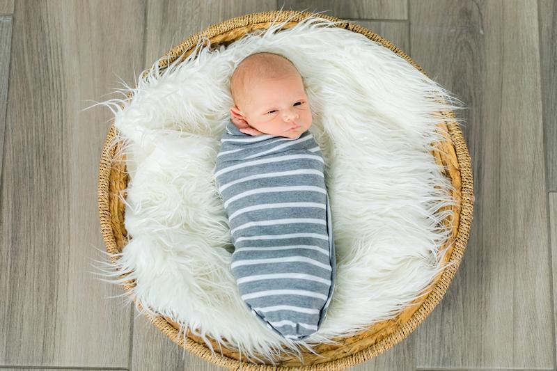 newborn in a striped wrap